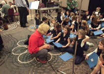 OCSTA president, Kathy Burtnik, with Our Lady of Sorrows elementary choir (Toronto Catholic DSB).