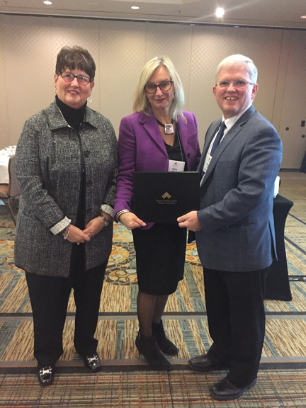 OCSTA President, Patrick Daly presenting 1st place short-video award to Dufferin-Peel CDSB represented by Trustees Sharon Hobin (left) and Anna da Silva.