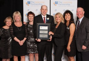 Outstanding Principal Award winner, Paul White (centre) and Kenora CDSB Director of Education, Phyllis Eikre